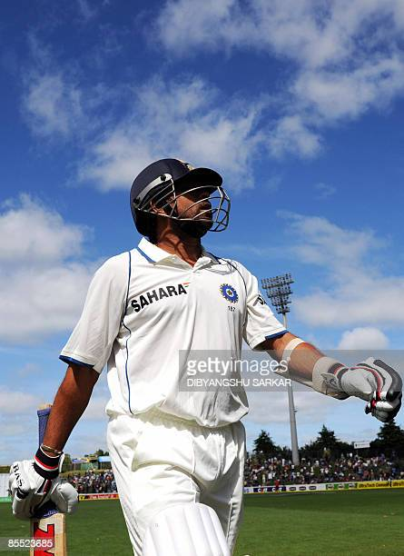 Indian cricketer Sachin Tendulkar walks back to the pavillion after loosing his wicket on his personal score of 160 runs during the third day of the...