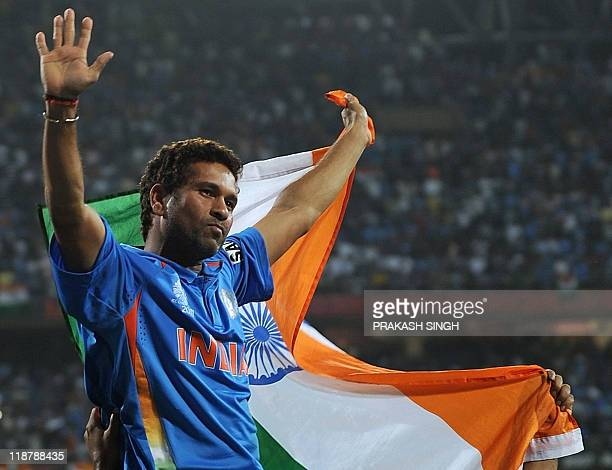 Indian cricketer Sachin Tendulkar waves the tricolor while celebrating victory during the final of ICC Cricket world Cup 2011 match between India and...