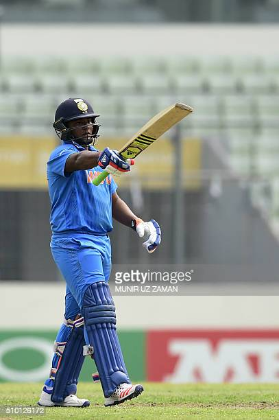 Indian cricketer Sarfaraz Khan acknowledges the crowd after a half century during the under19s World Cup cricket final between India and West Indies...
