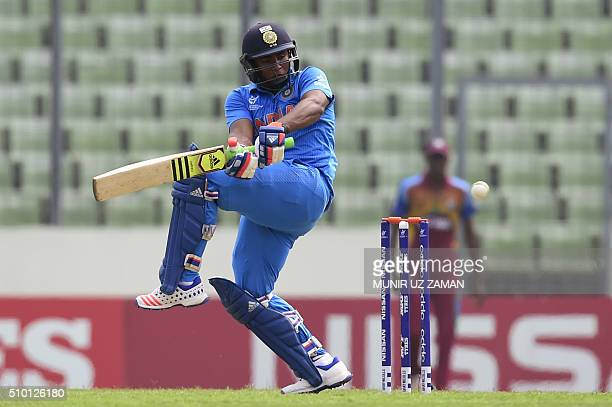 Indian cricketer Sarfaraz Khan plays a shot during the under19s World Cup cricket final between India and West Indies at the ShereBangla National...