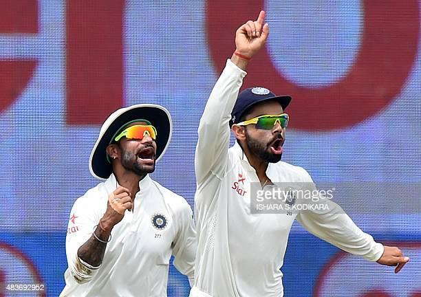 Indian cricketer Shikhar Dhawan and Indian cricket team captain Virat Kohli celebrate after the dismissal of Sri Lankan batsman Kaushal Silva during...