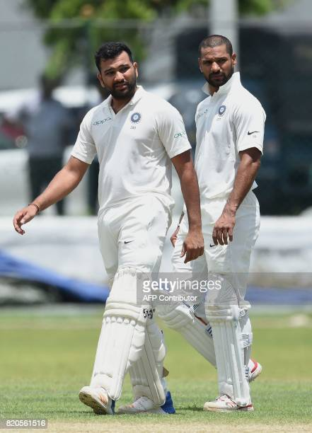 Indian cricketer Shikhar Dhawan and Rohit Sharma look on during the final day of the twoday warmup match between Sri Lanka Board President's XI and...