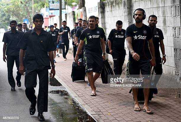 Indian cricketer Shikhar Dhawan and teammates arrive for a net practice session at the National Cricket Club in Colombo on August 4 2015 India will...