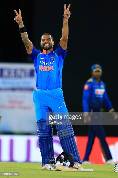 Indian cricketer Shikhar Dhawan celebrates after scoring hundred runs during the 1st One Day International cricket match bewtween Sri Lanka and India...