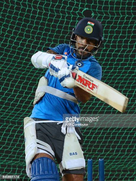 Indian cricketer Shikhar Dhawan plays a shot during a practice session at The RPeremadasa Stadium in Colombo on August 30 2017 The fourth one day...