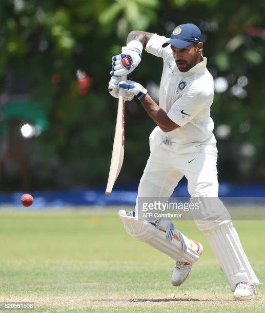 Indian cricketer Shikhar Dhawan plays a shot during the final day of the twoday warmup match between Sri Lanka Board President's XI and India at the...