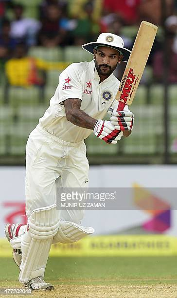 Indian cricketer Shikhar Dhawan plays a shot during the first day of the cricket Test match between Bangladesh and India at Khan Shaheb Osman Ali...