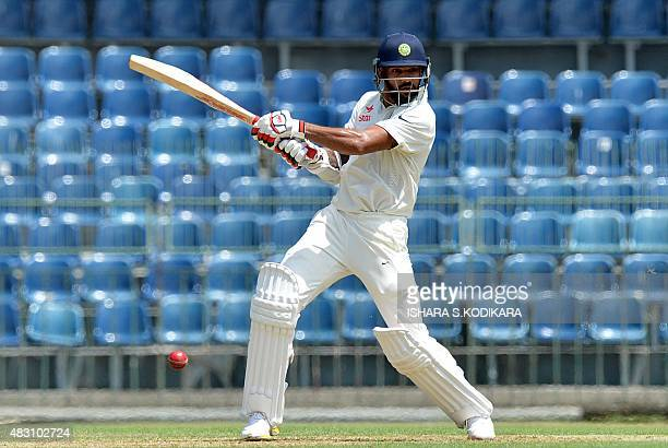 Indian cricketer Shikhar Dhawan plays a shot during the first day of the threeday warmup match between Sri Lanka Board President's XI and India at...