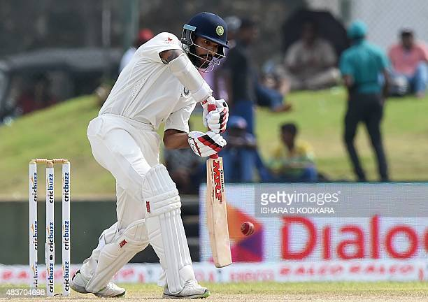 Indian cricketer Shikhar Dhawan plays a shot during the first day of the opening Test cricket match between Sri Lanka and India at The Galle...