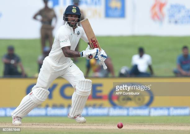 Indian cricketer Shikhar Dhawan plays a shot during the first day of first Test match between Sri Lanka and India at Galle International Cricket...