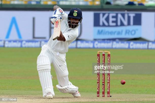 Indian cricketer Shikhar Dhawan plays a shot during the first day of the second Test match between Sri Lanka and India at the Sinhalease Sports Club...