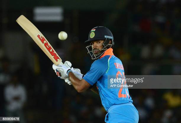 Indian cricketer Shikhar Dhawan plays a shot during the first One Day International cricket match between Sri Lanka and India at the Rangiri Dambulla...