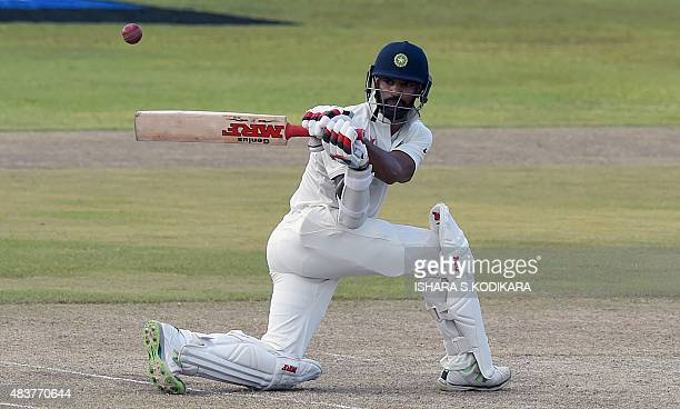 Indian cricketer Shikhar Dhawan plays a shot during the second day of the opening Test match between Sri Lanka and India at the Galle International...