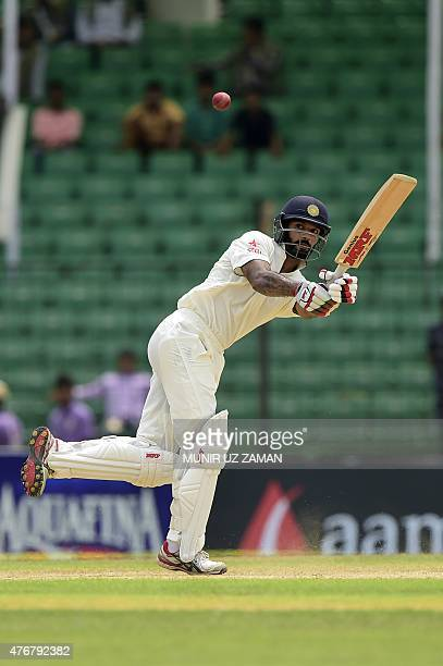 Indian cricketer Shikhar Dhawan plays a shot during the third day of the Test match between Bangladesh and India at Khan Shaheb Osman Ali Stadium in...