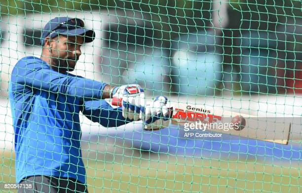 Indian cricketer Shikhar Dhawan plays a shot in the nets before the final day of the twoday warmup match between Sri Lanka Board President's XI and...
