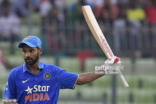 Indian cricketer Shikhar Dhawan reacts after scoring a half century during the third ODI cricket match between Bangladesh and India at the...