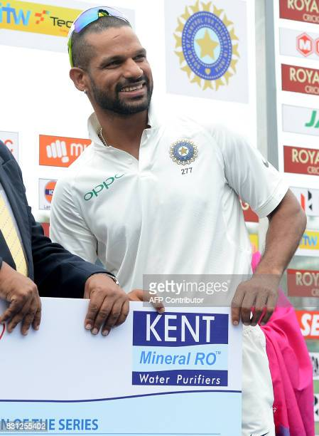 Indian cricketer Shikhar Dhawan takes Man of The Series prize after victory in the third day of the third and final Test match between Sri Lanka and...