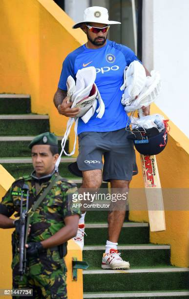 Indian cricketer Shikhar Dhawan takes part in a practice session at Galle International Cricket Stadium in Galle on July 24 2017 India will play...