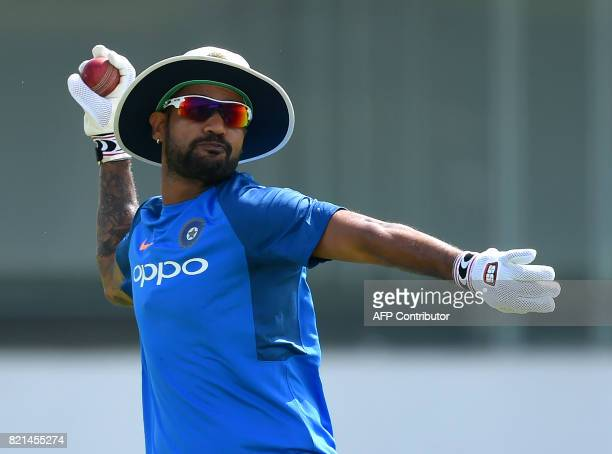 Indian cricketer Shikhar Dhawan throws a ball during a practice session at Galle International Cricket Stadium in Galle on July 24 2017 India will...