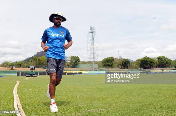 Indian cricketer Shikhar Dhawan warms up during a practice session at the Rangiri Dambulla International Cricket Stadium in Dambulla on August 18...