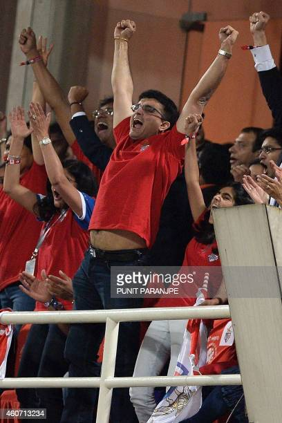 Indian cricketer Sourav Ganguly celebrates after Atletico de Kolkata won the Indian Super League final football match against Kerala Blasters at The...