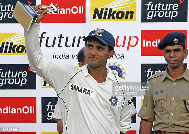 Indian cricketer Sourav Ganguly receives the man of the match trophy at the end of the third day of the third and final Test match between India and...