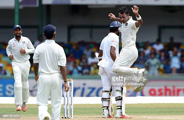 Indian cricketer Stuart Binny celebrates after he dismissed Sri Lankan cricketer Dinesh Chandimal during the third day of their third and final Test...