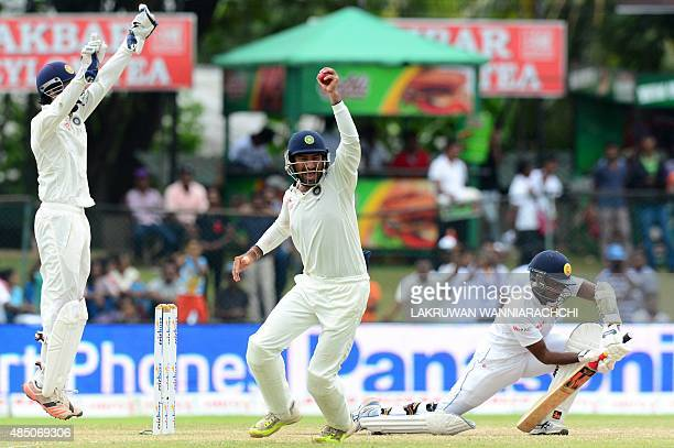 Indian cricketer Stuart Binny takes a catch to dismiss Sri Lankan cricketer Tharindu Kaushal during the final day of the second Test cricket match...