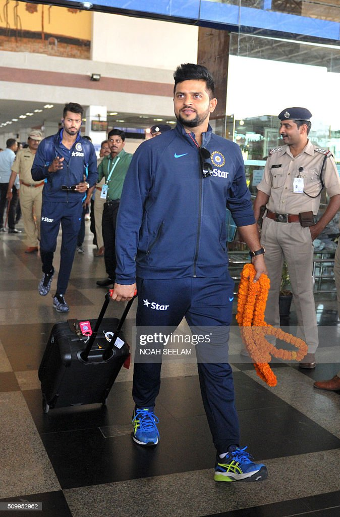 Indian cricketer Suresh Raina arrives at the airport in Visakhapatnam on February 13, 2016.The third T20 international match between India and Sri Lanka will be played on February 14. AFP PHOTO / Noah SEELAM. ---- IMAGE RESTRICTED TO EDITORIAL USE - STRICTLY NO COMMERCIAL USE ---- / AFP / NOAH SEELAM