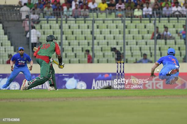 Indian cricketer Suresh Raina makes the catch to run out Bangladesh cricketer Soumya Sarkar during the first One Day International cricket match...
