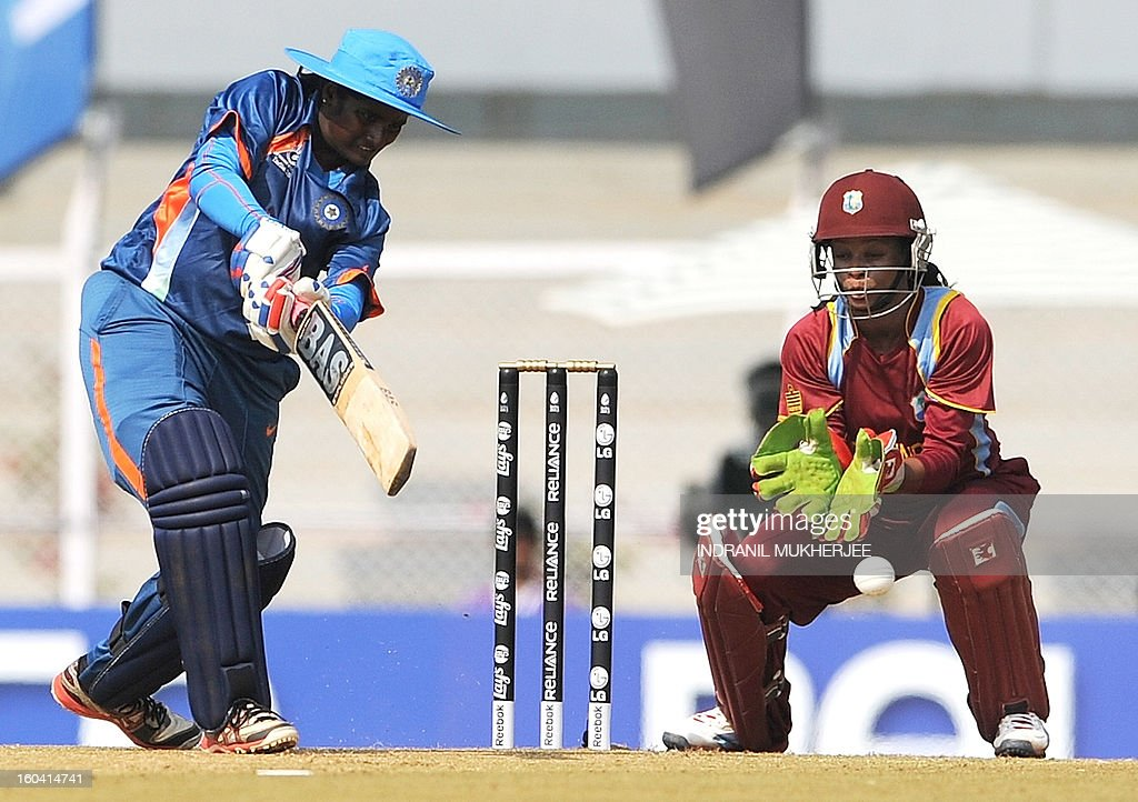 Indian cricketer Thirush Kamini (L) plays a shot as West Indian cricketer Merissa Aguelleria looks on during the inugural match of the ICC Women's World Cup 2013 between India and West Indies at the Cricket Club of India's Brabourne stadium in Mumbai on January 31, 2013. Teams from Australia, England, New Zealand, Pakistan, South Africa, Sri Lanka, West Indies join hosts India for the global event which is being played from 31 January to 17 February. The women's World Cup opened in Mumbai with the cricketers hoping to put aside memories of the unsavoury build-up and gain their due recognition in a country where the men's game reigns supreme. AFP PHOTO/ Indranil MUKHERJEE