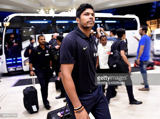 Indian cricketer Umesh Yadav arrives at a hotel in Colombo on August 3 2015 India will play three Test series matches in Sri Lanka between August 12...