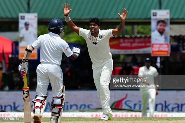 Indian cricketer Umesh Yadav celebrates after dismissing Sri Lankan cricketer Dimuth Karunaratne during the second day of their second test match...