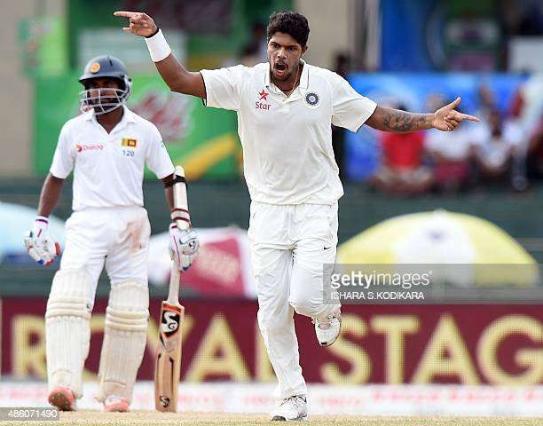 Indian cricketer Umesh Yadav celebrates after dismissing Sri Lankan cricketer Dimuth Karunaratne during the fourth day of their third and final Test...