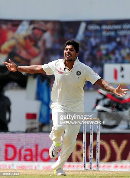 Indian cricketer Umesh Yadav celebrates after he dismissed Sri Lankan cricket captain Angelo Mathews during the final day of the second Test cricket...