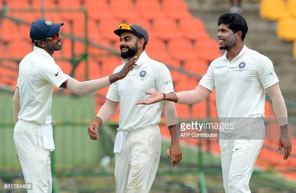 Indian cricketer Umesh Yadav celebrates with his teammates after he dismissed Sri Lankan cricketerin Niroshan Dickwella during the third day of the...