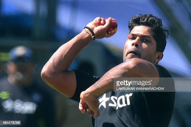 Indian cricketer Umesh Yadav delivers a ball during a practice session at the P Sara Oval Cricket Stadium in Colombo on August 19 ahead of a second...
