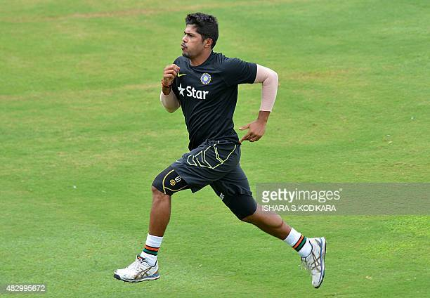 Indian cricketer Umesh Yadav run during a practice session at the R Premadasa International Cricket Stadium in Colombo on August 5 2015 The first...