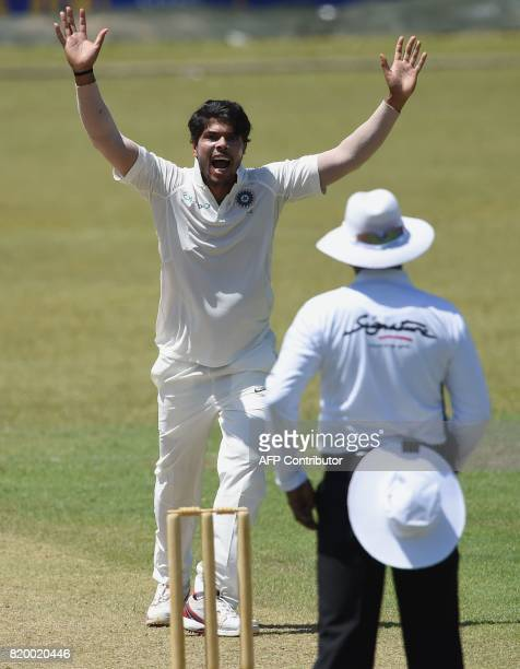 Indian cricketer Umesh Yadav successfully appeals for a leg before wicket decision against Sri Lanka Board President's XI cricketer Danushka...
