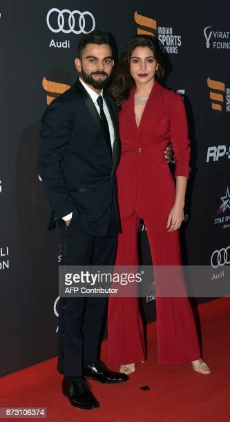 Indian cricketer Virat Kohli and Bollywood actress Anushka Sharma attend the Indian Sports Honour Awards 2017 in Mumbai on November 11 2017 / AFP...