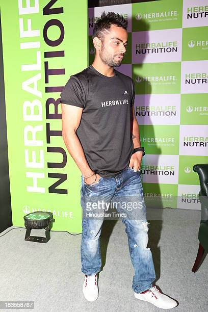 Indian cricketer Virat Kohli at press conference of Herballife at Le Meridien on October 1 2013 in Mumbai India Virat Kohli will be endorsing...