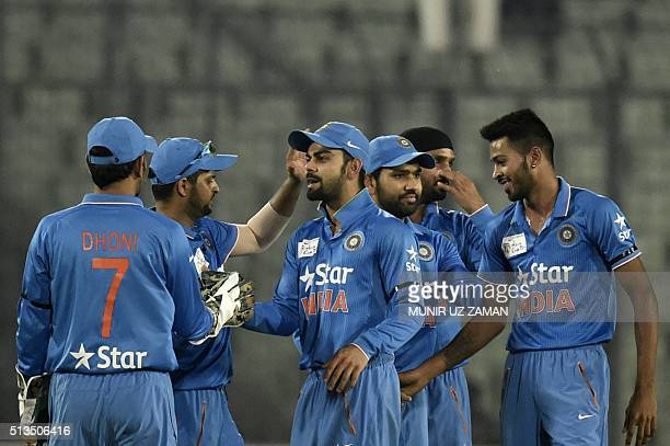 Indian cricketer Virat Kohli celebrates with teammates after the dismissal of unseen United Arab Emirates batsman Rohan Mustafa during the Asia Cup...