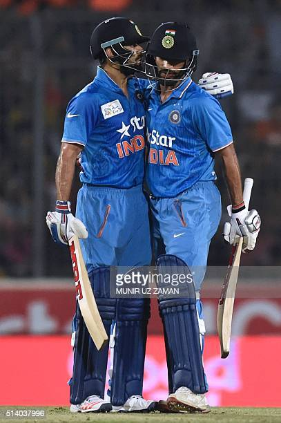Indian cricketer Virat Kohli hugs his teammate Shikhar Dhawan after hitting a boundery during the Asia Cup T20 cricket tournament final match between...