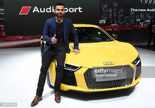 Indian cricketer Virat Kohli poses with the newly launched Audi R8 V10 plus at the Indian Auto Expo 2016 in Greater Noida on the outskirts of New...