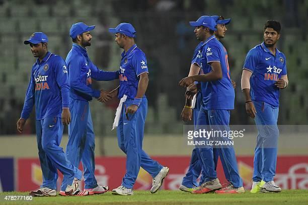 Indian cricketer Virat Kohli shakes hand with his teammate after winning the third ODI cricket match between Bangladesh and India at the ShereBangla...