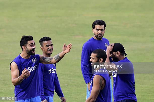 Indian cricketer Virat Kohli shares a light moment with teammates during a training session at the Khan Shaheb Osman Ali Stadium in Fatullah on...