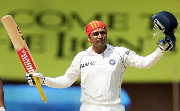 Indian cricketer Virender Sehwag celebra : News Photo