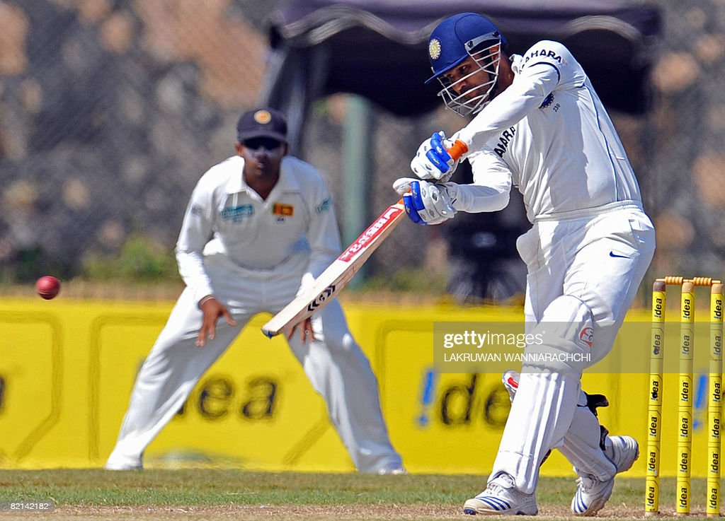 Indian cricketer Virender Sehwag (R) is : News Photo
