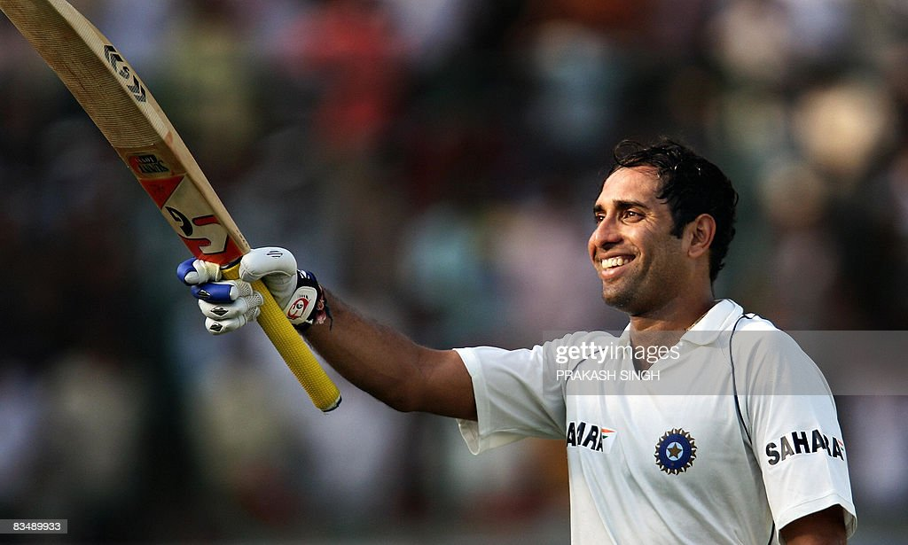 Indian cricketer V.V.S. Laxman raises hi : News Photo
