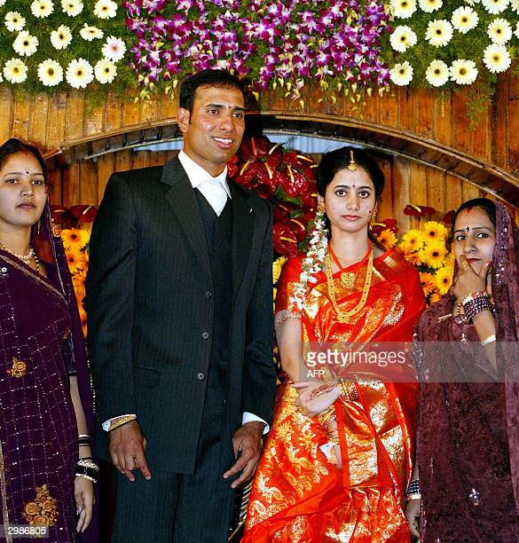 Indian cricketer VVS Laxman stands along with his bride Gudpati Raghava Sailaja as they pose for photographs along with other relatives during their...